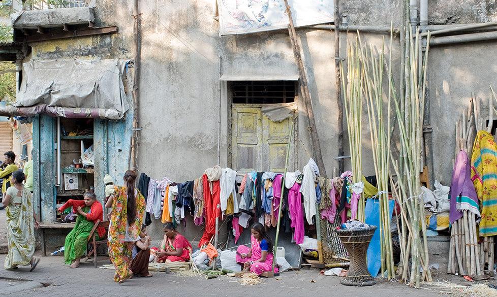 Women weaving baskets in pavement