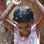 girls playing with water and soap