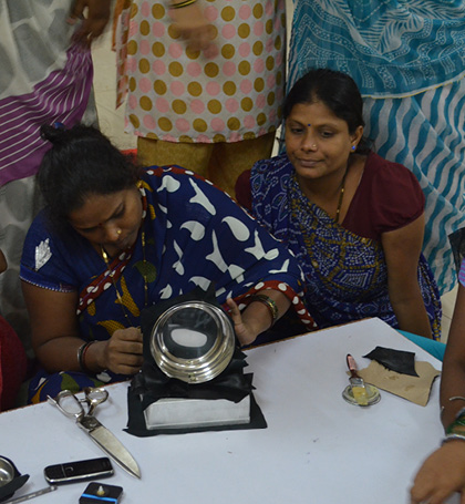 Women making Matka vase at workshop